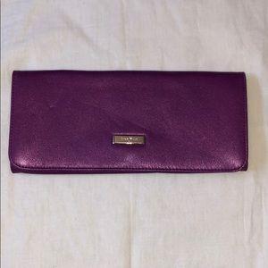 Little purple clutch by Cole Haan